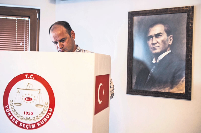 A Turkish citizen living in Kosovo casts his ballot for the upcoming Turkish general elections at the Turkish embassy in Pristina on May 31, 2015.