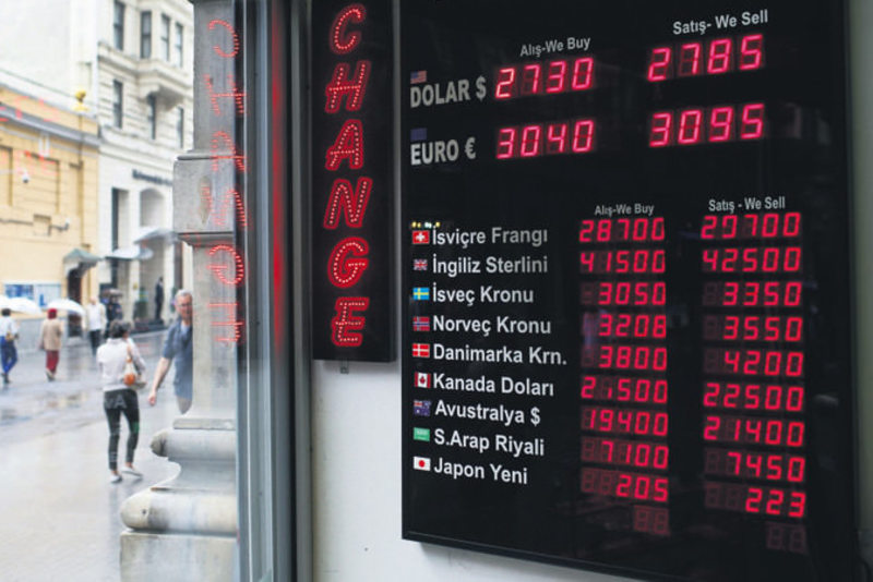 A currency exchange office in Istanbul, Monday, June 8. The Turkish currency yesterday dropped to a record low against the dollar over political uncertainty, trading at TL 2.8 to the dollar.