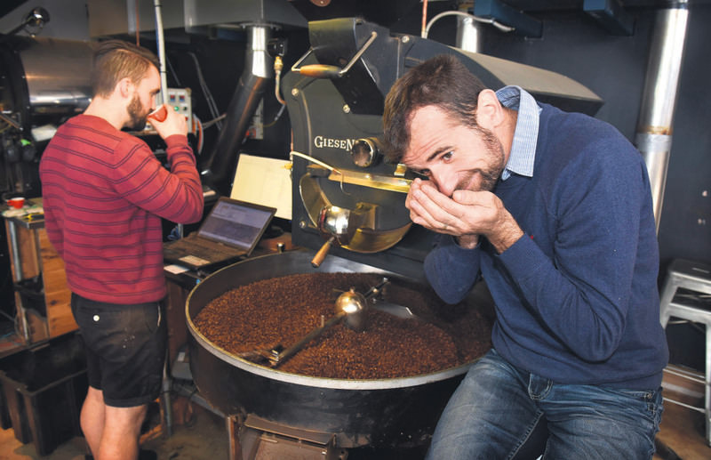 Coffee maker and cafu00e9 owner Sasa Sestic (R) at his roasting facility in Australia's capital Canberra.He won the World Barista Championship this year.