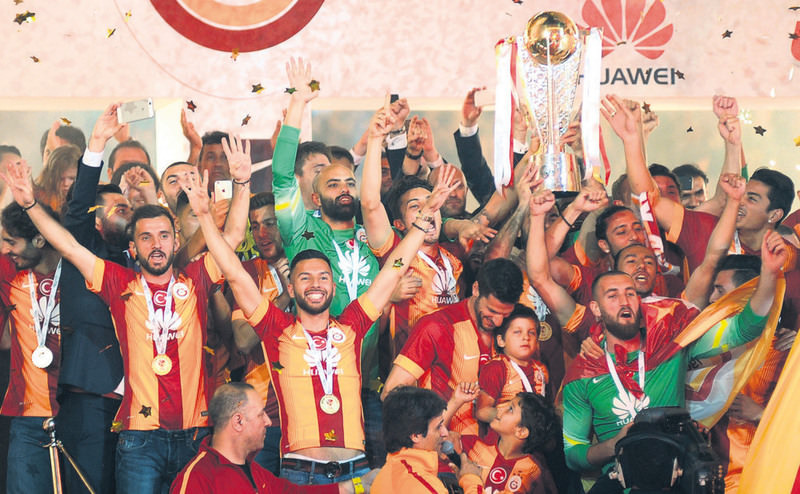 Galatasaray players celebrate their Turkish Super League trophy during a championship ceremony at TT Arena in Istanbul. Galatasaray won the Turkish league title for the 20th time.