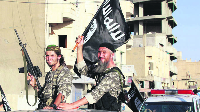 ISIS militants wave their flag in Syria's Raqqa, one of its strongholds.