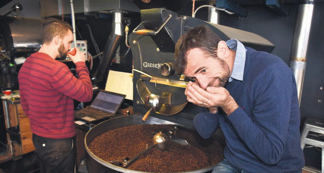 Coffee maker and café owner Sasa Sestic (R) at his roasting facility in Australia's capital Canberra.He won the World Barista Championship this year.