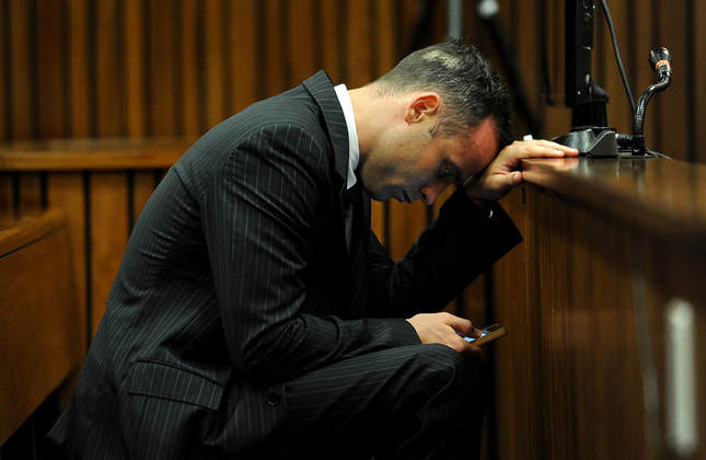 Pistorius waiting for trial in March 2014 (AP Photo)