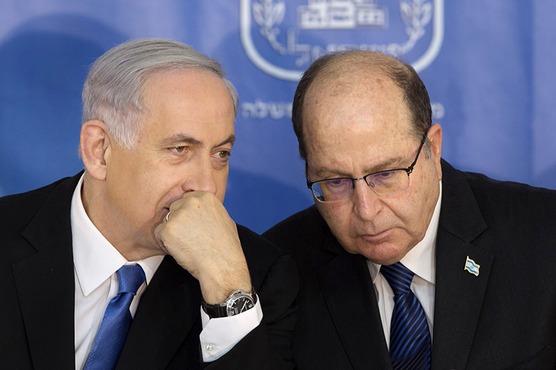 Israeli PM Benjamin Netanyahu, left, speaks with Israel's Defense Minister Moshe Yaalon during a ceremony for new Israeli Chief of Staff Gadi Eizenkot at the PMu2019s office in Jerusalem on Feb. 16, 2015 (AP Photo)