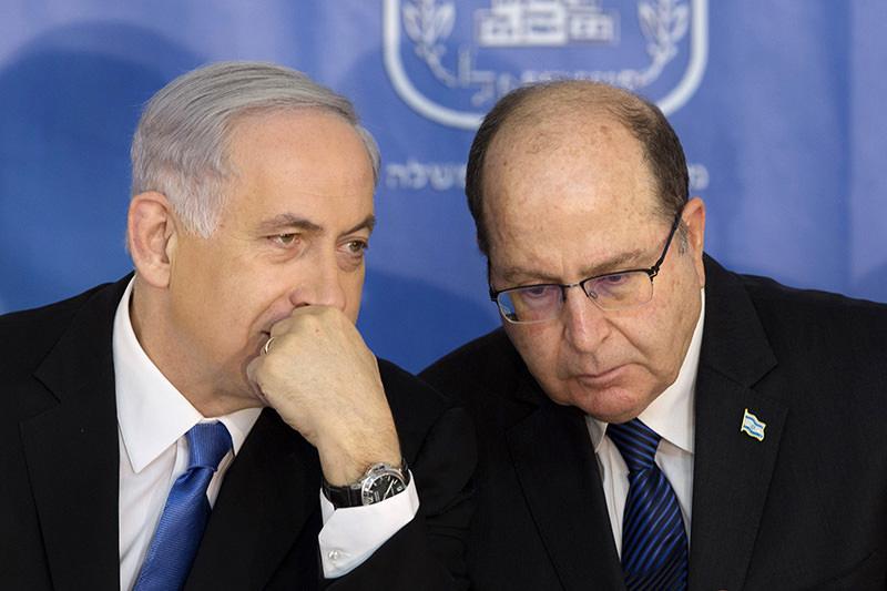 Israeli PM Benjamin Netanyahu, left, speaks with Israel's Defense Minister Moshe Yaalon during a ceremony for new Israeli Chief of Staff Gadi Eizenkot at the PMu2019s office in Jerusalem on Feb. 16, 2015 (AP Photo)