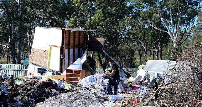 Residents begin cleaning up after a bulldozer destroyed their home at Teralba, near Newcastle, in the New South Wales Hunter region, Australia, 09 June 2015 (EPA Photo)