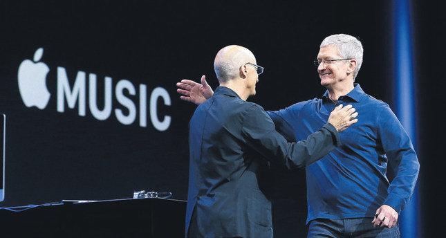 Apple CEO Tim Cook, right, hugs Beats by Dre co-founder and Apple employee Jimmy Iovine at the Apple Worldwide Developers Conference in San Francisco.