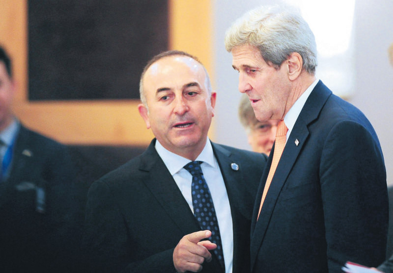 Foreign Minister Mevlu00fct u00c7avuu015fou011flu talks with U.S. Secretary of State John Kerry at a NATO meeting in Antalya on May 13, 2015.