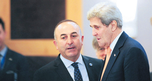 Foreign Minister Mevlüt Çavuşoğlu talks with U.S. Secretary of State John Kerry at a NATO meeting in Antalya on May 13, 2015.
