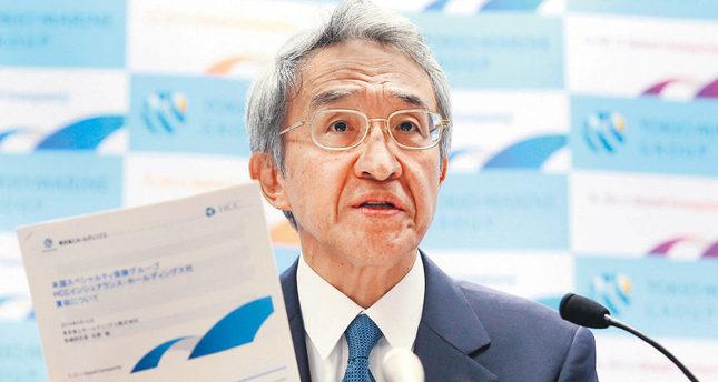 The president of Japanese insurer Tokio Marine Holdings, Tsuyoshi Nagano, speaks to the media as he announces the company will buy U.S.-based HCC Insurance Holdings in Tokyo on June 10.