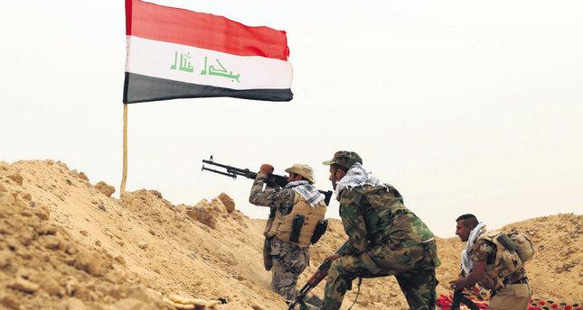 Iranian-backed Shiite militias fighting against ISIS militants.