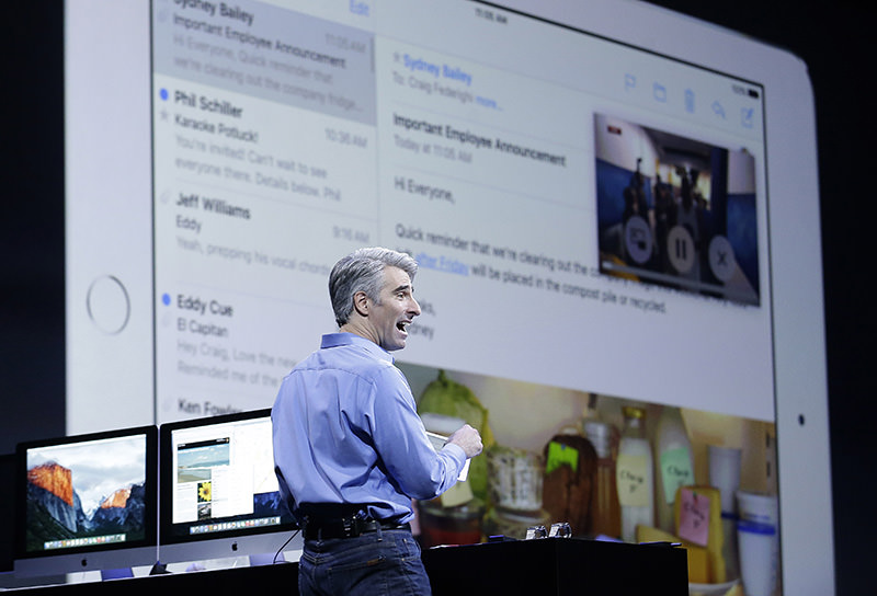 Craig Federighi, Apple senior vice president of Software Engineering, demonstrates the multitask feature on an iPad at the Apple Worldwide Developers Conference in San Francisco. (AP Photo)