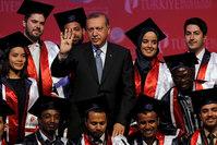 Turkey's President Tayyip Erdoğan poses with students during a graduation ceremony in Ankara, Turkey, June 11, 2015 (REUTERS Photo)