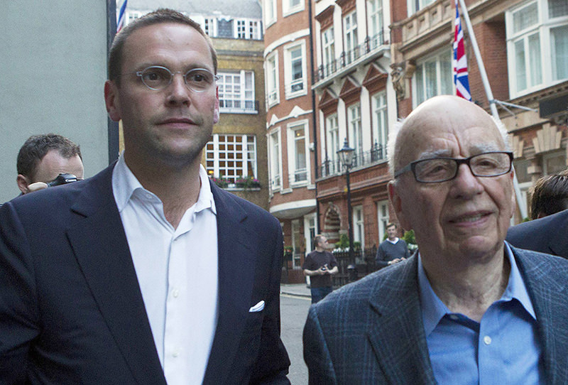 News International Chairman, James Murdoch (L) and his father Rupert leave the Stafford Hotel in central London in this July 10, 2011 (Reuters Photo)