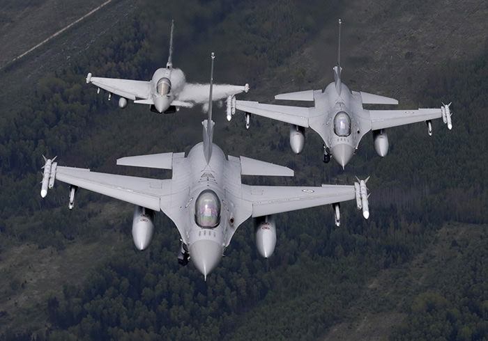 Norway's Air Force F-16 fighters (front) and Italy's Air Force Eurofighter Typhoon fighter patrol over the Baltics during a NATO air policing mission from Zokniai air base near Siauliai, Lithuania, May 20, 2015 (Reuters Photo)
