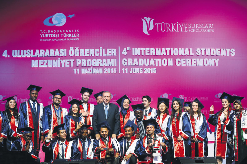 President Erdou011fan poses with foreign students at the graduation ceremony. Turkey is a hub for foreign students especially from Asian, African and Middle Eastern countries.