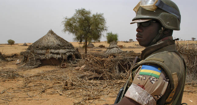 An African Union soldier surveys the abandoned village of Hashaba, south of El-Fasher in the war-torn Sudanese region of Darfur on June 9. (AFP Photo)