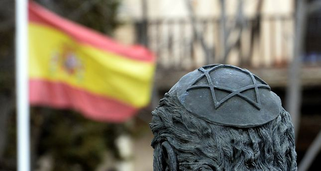 A file picture taken on February 27, 2014 shows a sculpture of Samuel Halevi Abulafia and a Spanish flag near the El Transito synagogue and Sephardic Museum in Toledo. (AFP Photo)