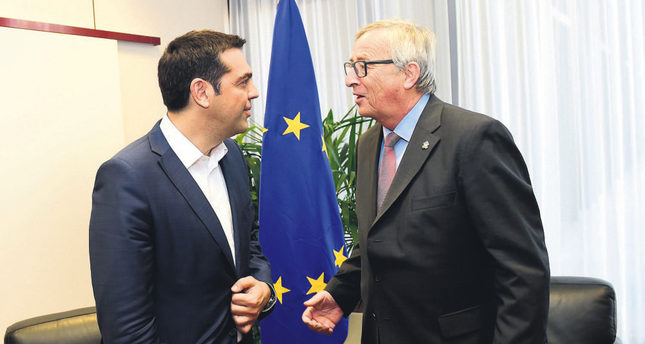 Greek PM Tsipras (L) and European Commission President Juncker participate in a bilateral meeting on the sidelines of the EU-CELAC summit in Brussels.