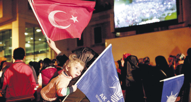 AK Party supporters wave party and Turkish flags at the party's headquarters in Istanbul on June 7.