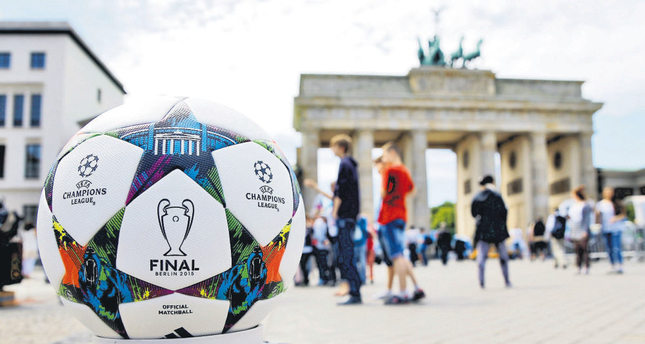 The official match ball for the UEFA Champions League final, produced by German sportswear firm Adidas, is pictured in front of the Brandenburg gate.