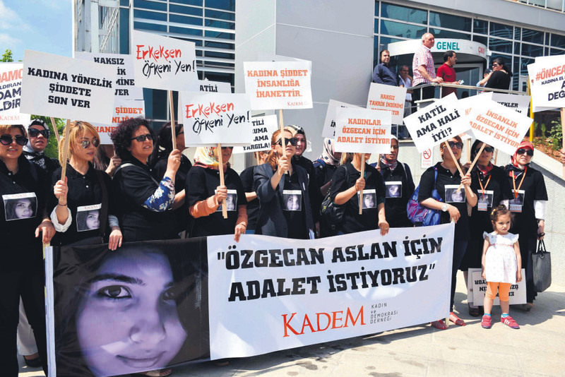 Activists from the NGO KADEM holding a banner reading ,Justice For u00d6zgecan, with a photo of the slain woman. It is a high-profile trial as the murder had triggered nationwide protests against violence targeting women.