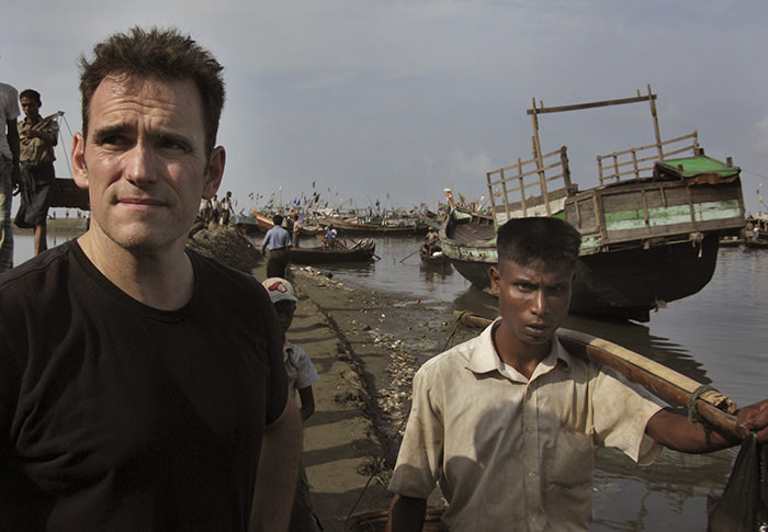 American actor Matt Dillon, left, stands with a Rohingiya man at Thay Chaung harbor, north of Sittwe in the western state of Rakhine, Myanmar (AP Photo)