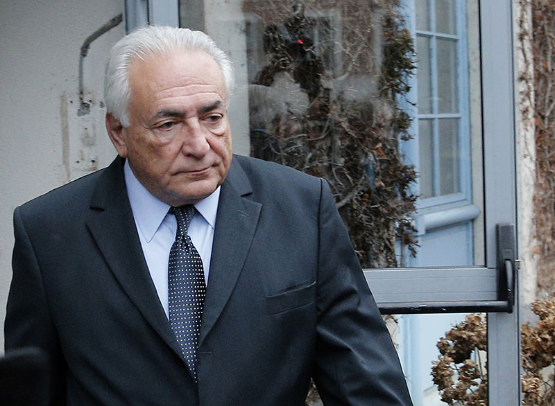 File image shows former Managing Director of IMF Dominique Strauss Kahn leaving his hotel in Lille, France, as he goes on trial for sex charges at a court on Feb. 11, 2015 (AP Photo)