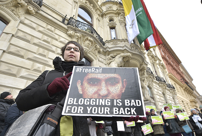 members of the Austrian Greens protest against the punishment for Saudi blogger Raif Badawi in front of the KAICIID in Vienna, Austria (AP Photo)