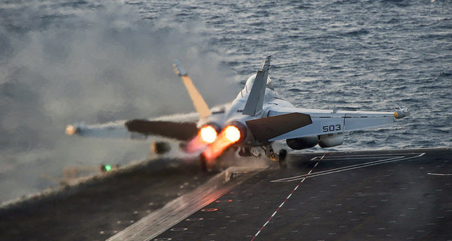 An EA-18G Growler launches from the Nimitz-class aircraft carrier USS Carl Vinson (CVN 70) in this U.S. Navy picture taken in the Arabian Gulf October 28, 2014 (Reuters Photo)