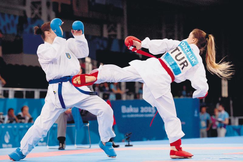 Serap u00d6zu00e7elik defeated current European gold medalist Bettina Plank of Austria in the highly competitive women's kumite 50 kilogram class.