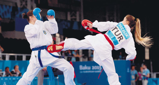 Serap Özçelik defeated current European gold medalist Bettina Plank of Austria in the highly competitive women's kumite 50 kilogram class.