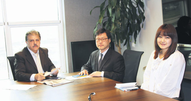 Daily Sabah's Turan (L) met with Cheong, the chief of KEXIM's Istanbul office (C), to discuss the bank's activities.