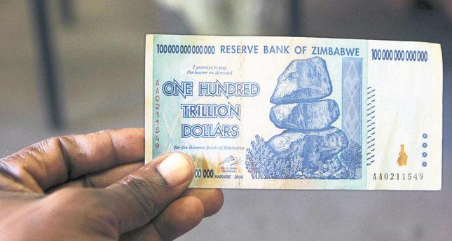 Zimbabweans get $5 for 175 quadrillion local dollars