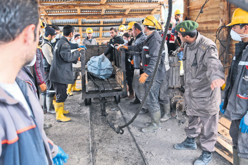 Workers pull a cart with the body of a miner in November 2014 in Ermenek. Eighteen miners were killed when their mine was flooded, allegedly due to deliberate ignorance of the mine owner.