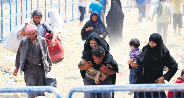Syrians accuse PYD of 'ethnic cleansing' as more flee to Turkey