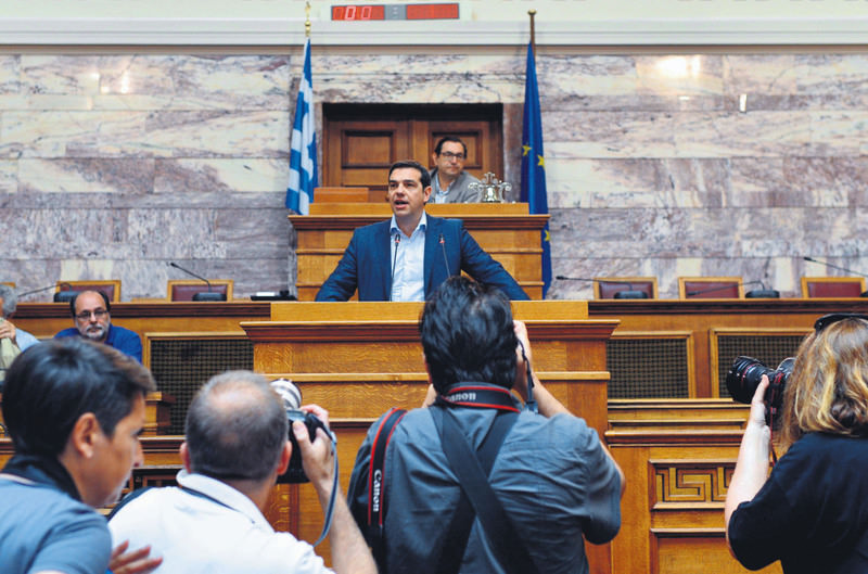 Greek PM Tsipras addresses lawmakers during a parliamentary group meeting at the Greek parliament in Athens yesterday.