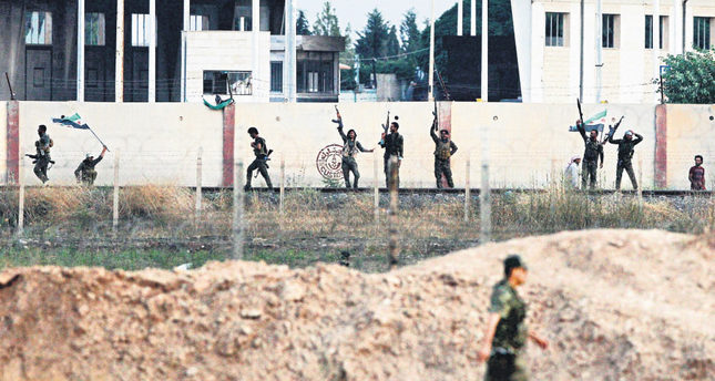 ISIS loses Tal Abyad as Turkey denounces Kurdish cantons