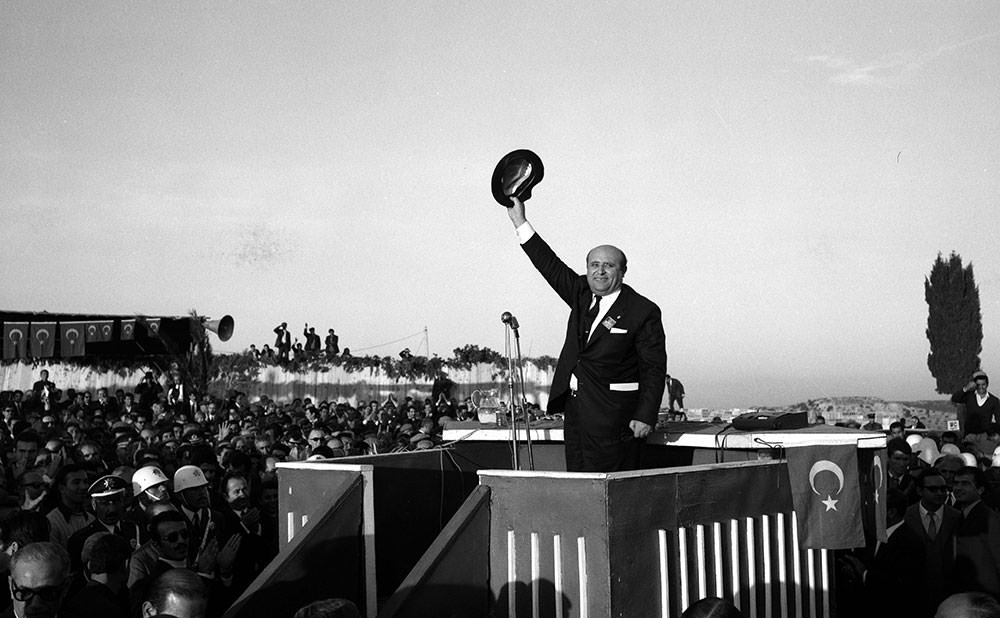 Demirel in Adana in 1960's, saluting the crowd with his famous hat