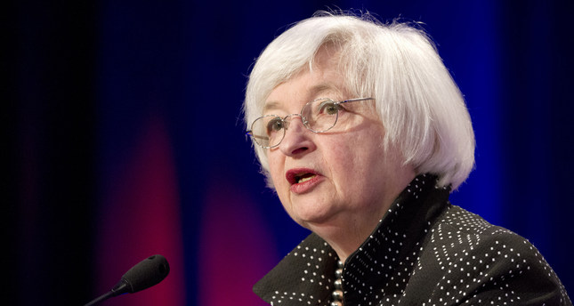 Fed sees stronger US economy but keeps rates unchanged