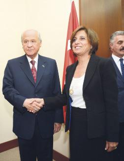 MHP chairman Bahçeli (L) receives TÜSİAD Chairwoman Symes (R) in Ankara.