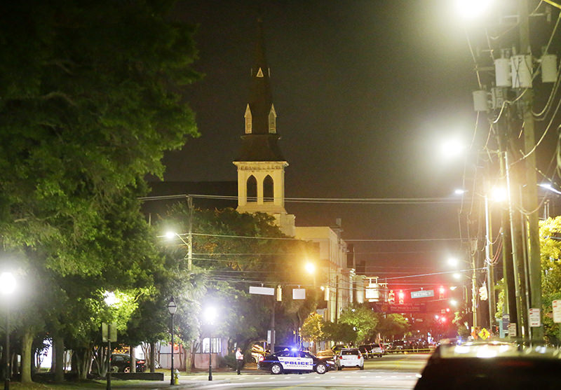 The steeple of Emanuel AME Church is visible as police close off a section of Calhoun Street early Thursday, June 18, 2015 following a shooting Wednesday night in Charleston, S.C. (AP Photo)