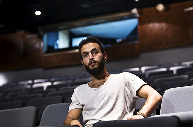 Bashar Murkus, author and director of 'A Parallel Time, sits in Almidan theater during an interview, in the Israeli northern city of Haifa June 17, 2015 (Reuters Photo)