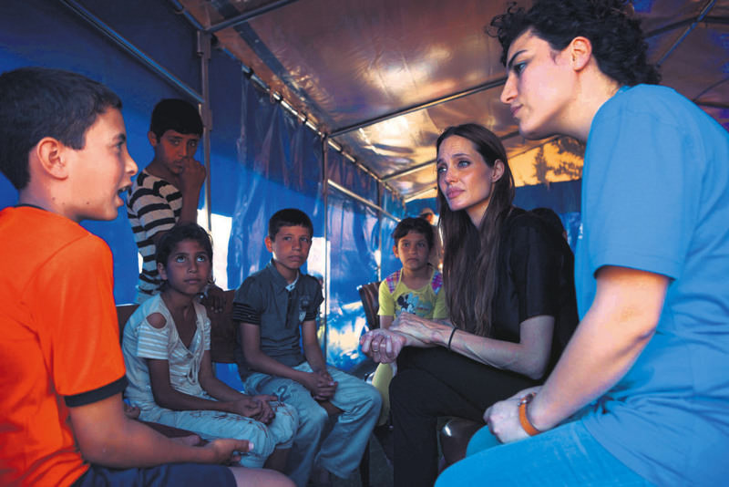 Angelina Jolie talking to Syrian refugees during a 2011 visit to the refugee camp in Hatay province's Altu0131nu00f6zu00fc district.