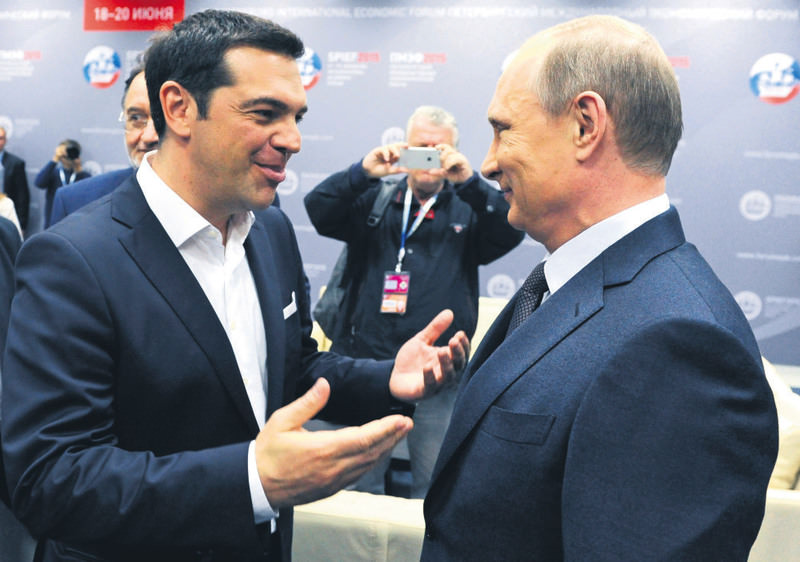Greek PM Tsipras (L) and Russian President Putin speak at an economic forum in St. Petersburg on Friday. Russia and Greece agreed on extending the Turkish Stream pipeline project to Greek territory.