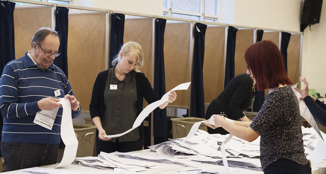 Ballots cast for the Danish parliamentary election are counted at a polling station in Copenhagen, Thursday, June 18, 2015. (AP Photo)