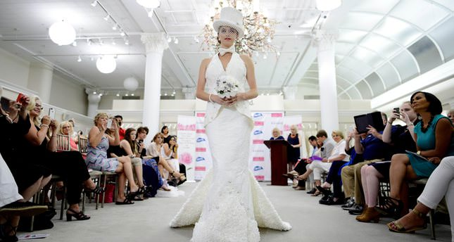 Model Aubrey Swander walks the runway in a dress, which won first place and was designed by Donna Pope Vincler, of Brentwood, Tennessee, during the 11th annual Toilet Paper Wedding Dress contest in New York. (EPA Photo)