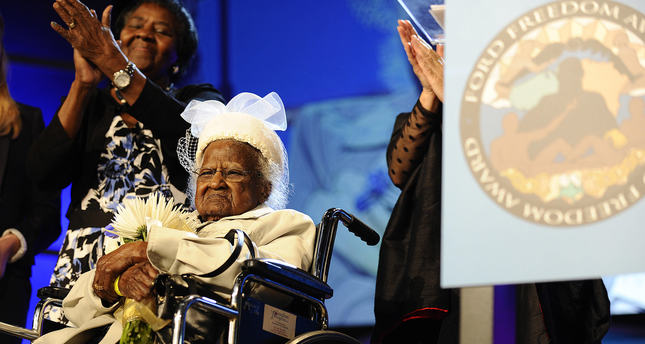 This photo taken May 5, 2015, shows Jeralean Talley, of Inkster, Mich., getting a round of applause after being introduced during the Ford Freedom Award Ceremony in Detroit. (AP Photo)