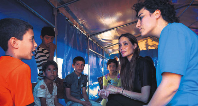 Angelina Jolie talking to Syrian refugees during a 2011 visit to the refugee camp in Hatay province's Altınözü district.