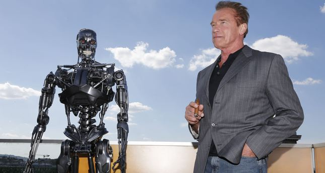Actor Arnold Schwarzenegger poses for photographers at a preview of his new film, 'Terminator: Genisys', in Paris, France, June 19, 2015. (AP Photo